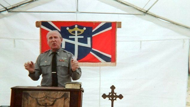 A photo from Arthur Jones' campaign website shows him speaking at the Aryan Nations 2014 World Congress i