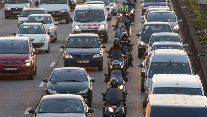 Motorcyclists split a lane in France in 2016. In the United States, only California allows lane-splitting.