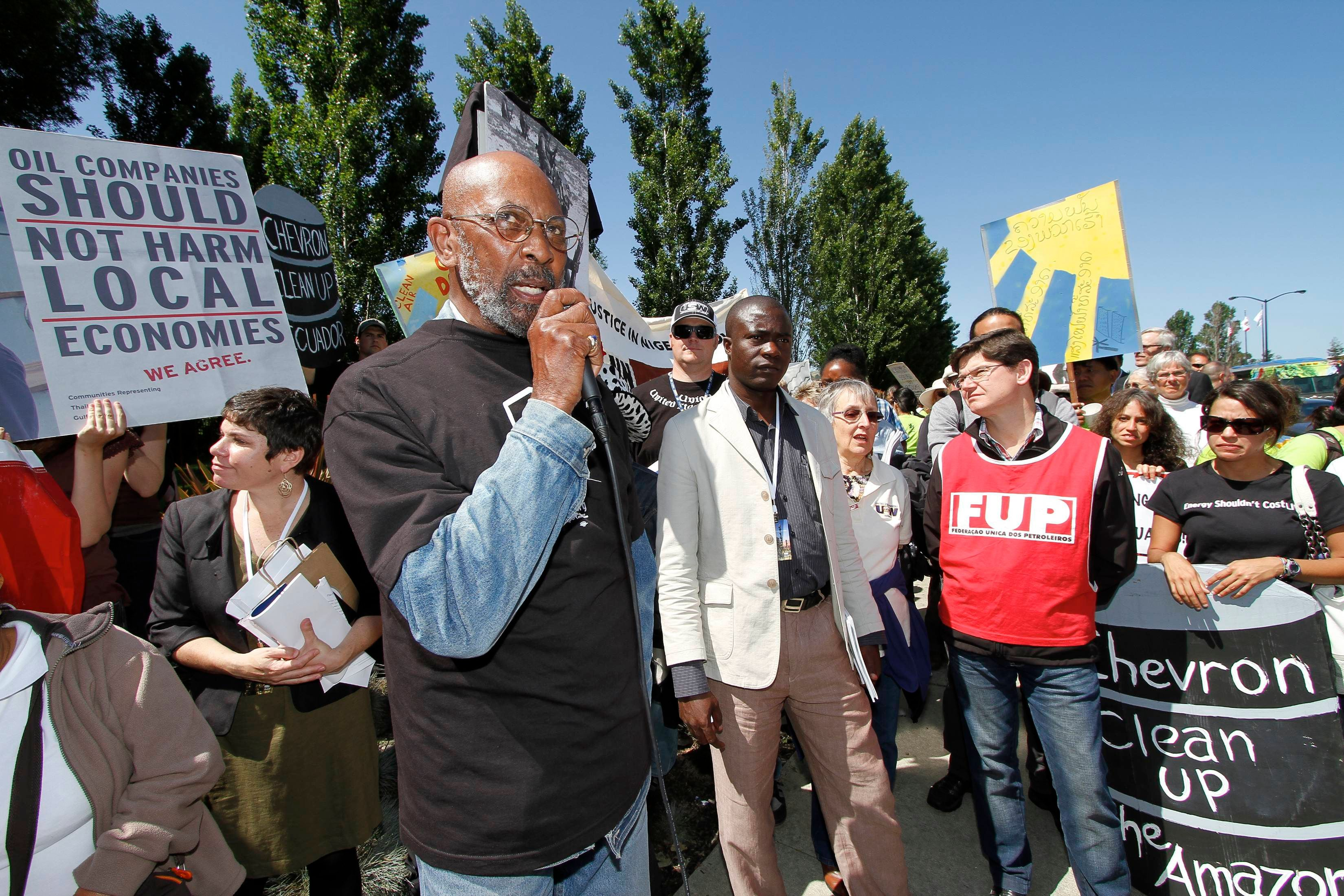 Kenneth Davis who lives near a Chevron refinery in North Richmond, California, speaks during a protest outside the annual mee