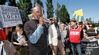 Kenneth Davis who lives near a Chevron refinery in North Richmond, California speaks during a protest outside the annual meeting at Chevron Corp headquarters in San Ramon, California May 30, 2012. REUTERS/Kevin Bartram (UNITED STATES - Tags: POLITICS CIVIL UNREST BUSINESS)