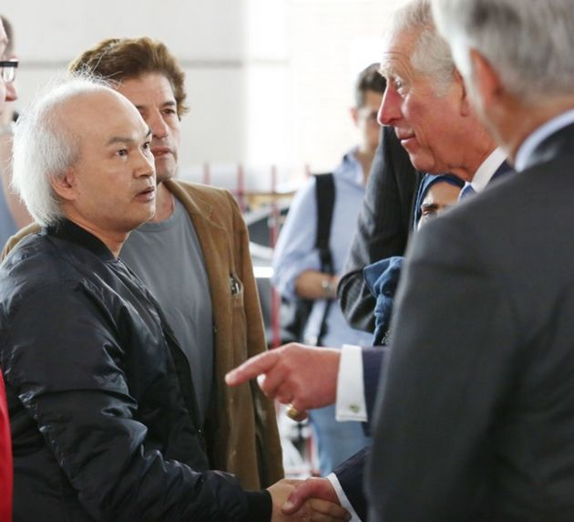 Anh Nhu Nguyen, left in dark shirt, met the Prince of Wales in the aftermath of the