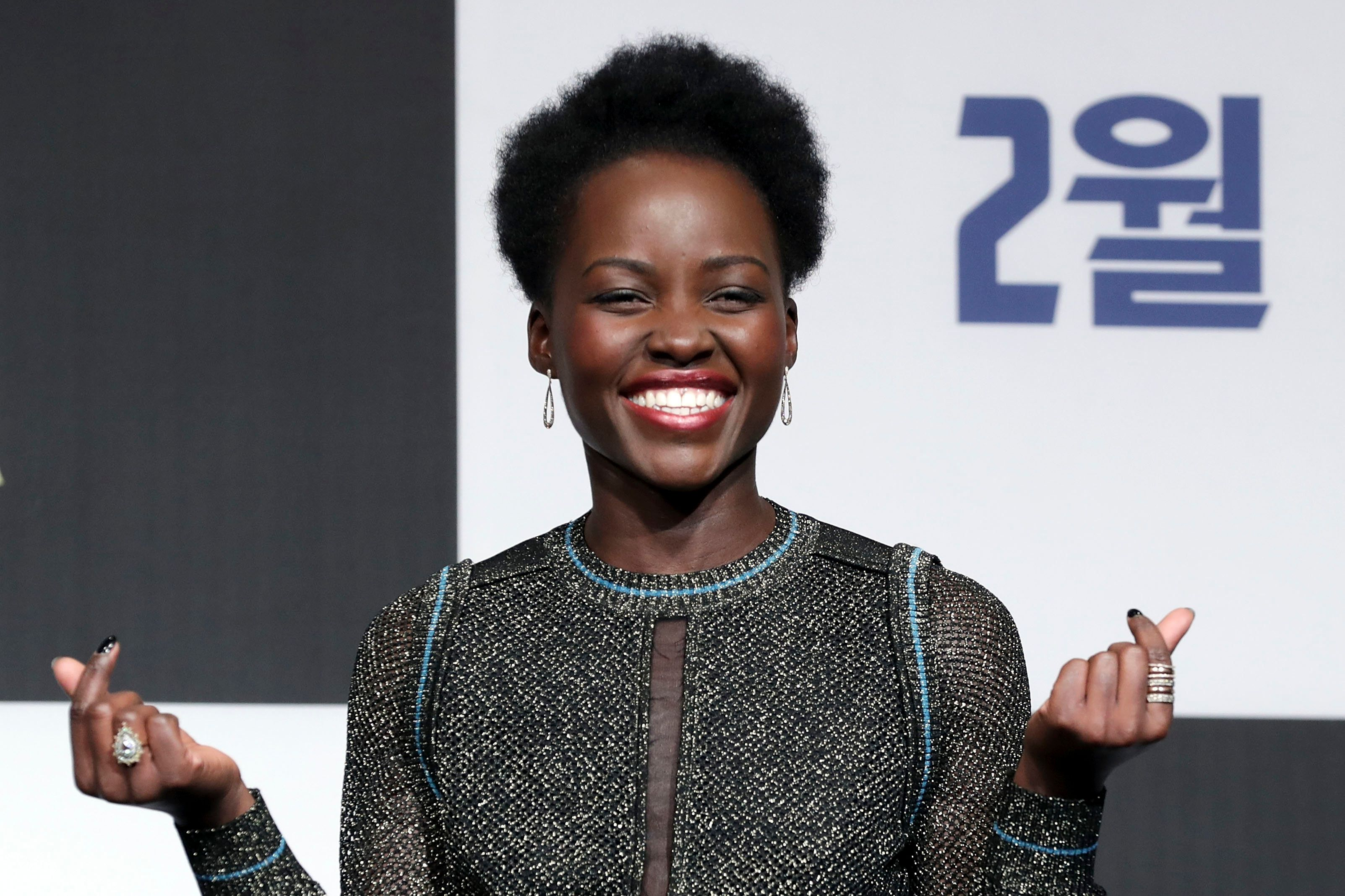 Lupita Nyong'o pulls a double finger heart at the Seoul premiere of