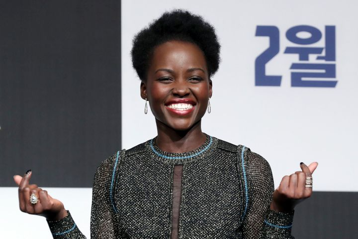 """Lupita Nyong'o pulls a double finger heart at the Seoul premiere of """"Black Panther"""" earlier this month."""