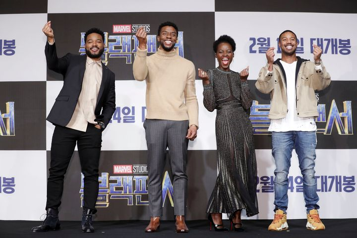 "From left, ""Black Panther"" director Ryan Coogler flashes a finger heart alongside actors Chadwick Boseman, Lupita Nyong'o and"