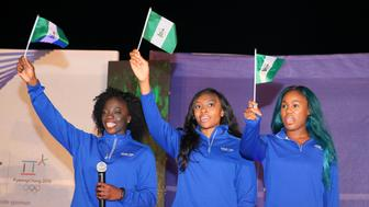Nigerian women's bobsled team members Seun Adigun, Ngozi Onwumere and Akuoma Omeoga wave Nigeria flags during a reception organised for them in Lagos, Nigeria, as part of preparations ahead of the 2018 Pyeongchang Winter Olympic Games, February 2, 2018. REUTERS/Afolabi Sotunde