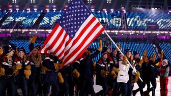 USA's delegation and flagbearer Erin Hamlin parade during the opening ceremony of the Pyeongchang 2018 Winter Olympic Games at the Pyeongchang Stadium on February 9, 2018. / AFP PHOTO / Odd ANDERSEN        (Photo credit should read ODD ANDERSEN/AFP/Getty Images)