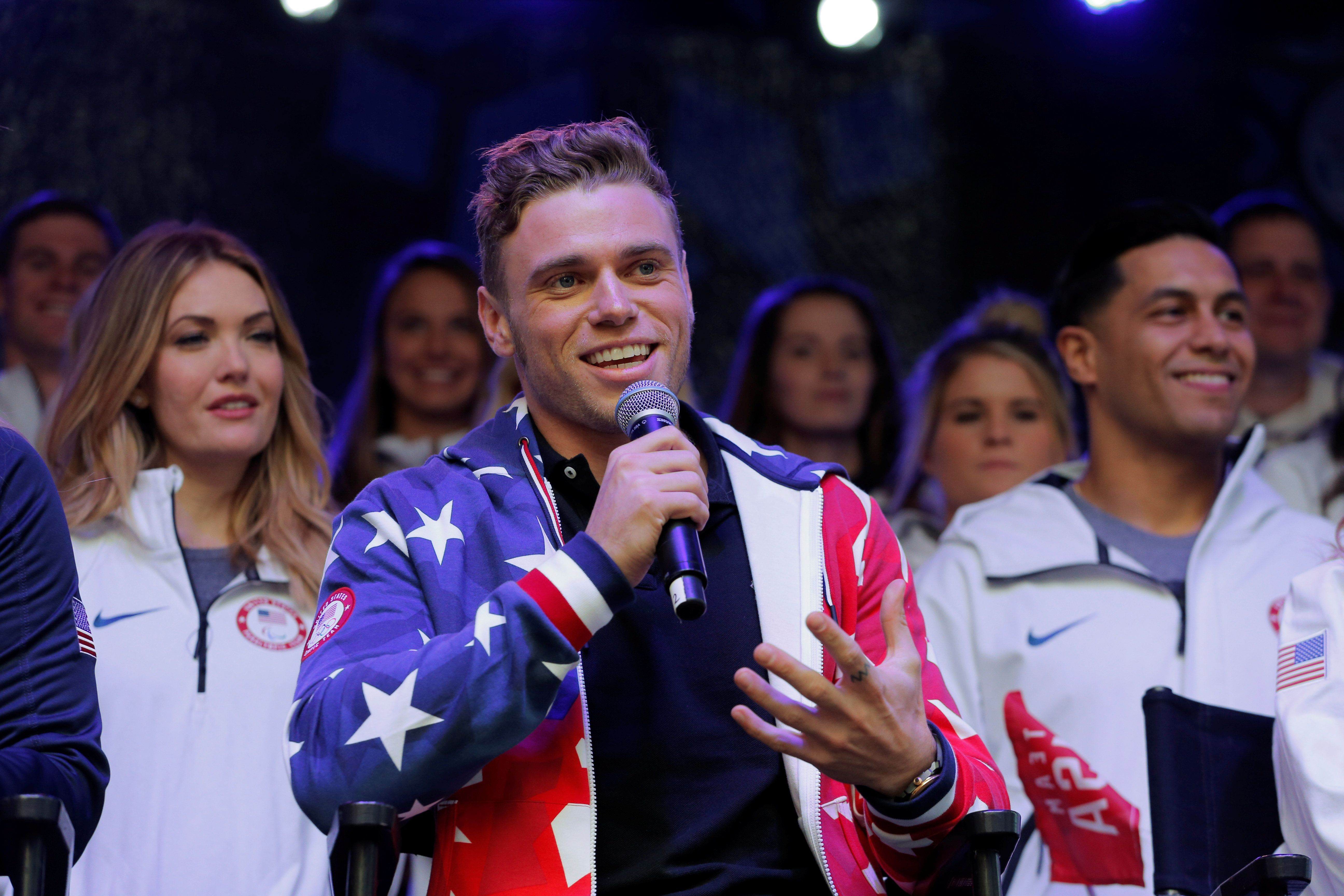 Olympian freestyle skier Gus Kenworthy speaks during an event in Times Square to celebrate 100 days from the start of the PyeongChang 2018 Olympic Games in South Korea, in New York, U.S., November 1, 2017.  REUTERS/Lucas Jackson