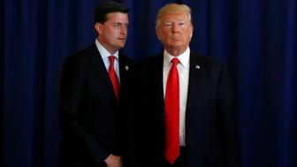 White House Staff Secretary Rob Porter (L) reminds U.S. President Donald Trump he had a bill to sign after he departed quickly following remarks at his golf estate in Bedminster, New Jersey U.S., August 12, 2017. Picture taken August 12, 2017.  REUTERS/Jonathan Ernst