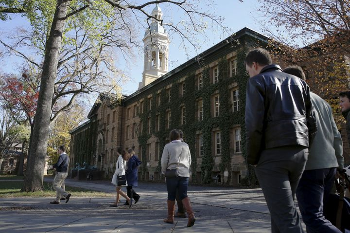People walk past Princeton University's Nassau Hall in Princeton, New Jersey, on Nov. 20, 2015.