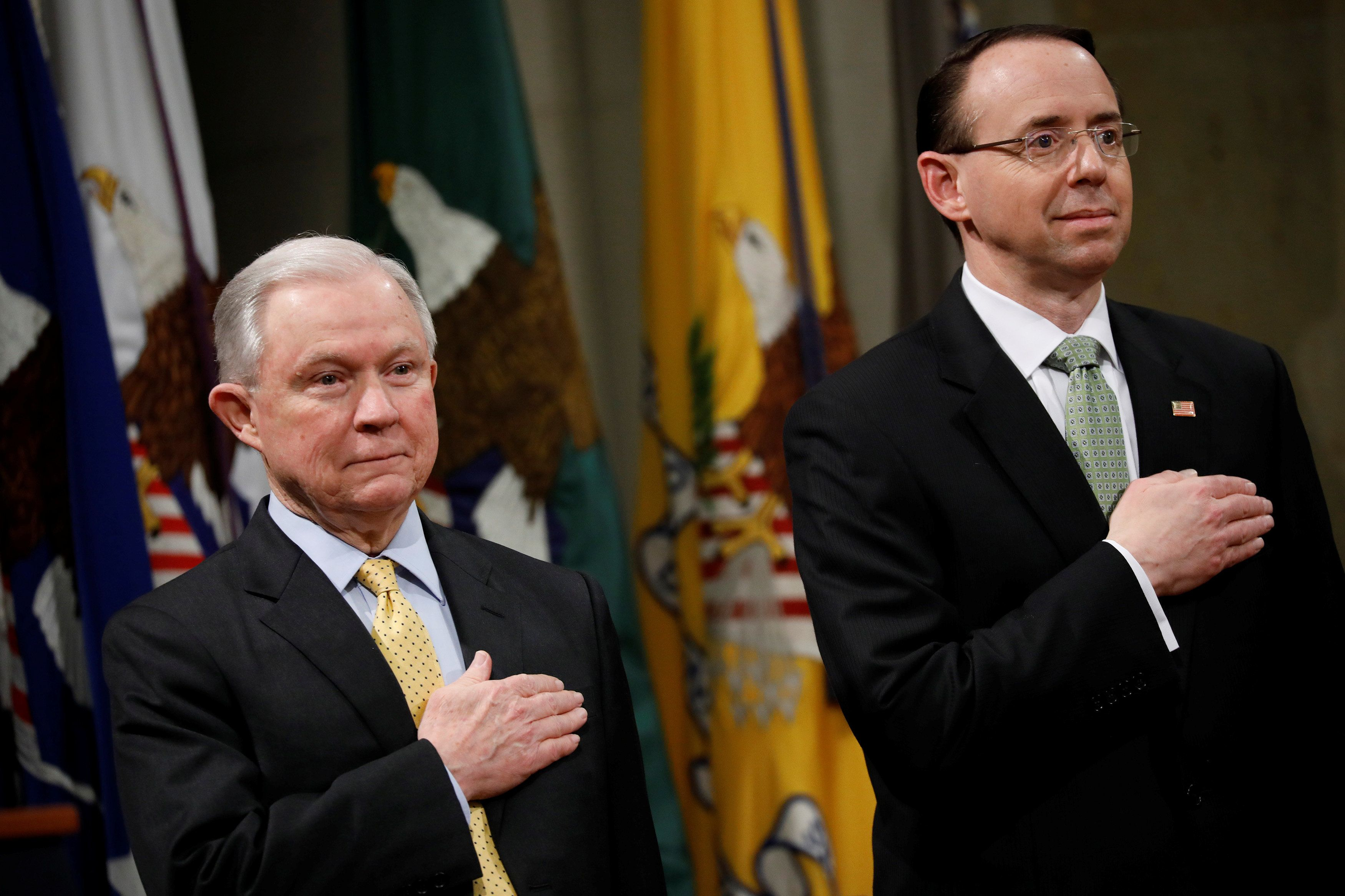United States Attorney General Jeff Sessions (L) and Deputy Attorney General Rod Rosenstein stand for the pledge of allegiance at a summit about combating human trafficking at the Department of Justice in Washington, U.S., February 2, 2018. REUTERS/Aaron P. Bernstein