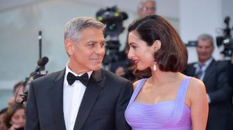 VENICE, ITALY - SEPTEMBER 02:  George Clooney and Amal Clooney walk the red carpet ahead of the 'Suburbicon' screening during the 74th Venice Film Festival at Sala Grande on September 2, 2017 in Venice, Italy.  (Photo by Dominique Charriau/WireImage)