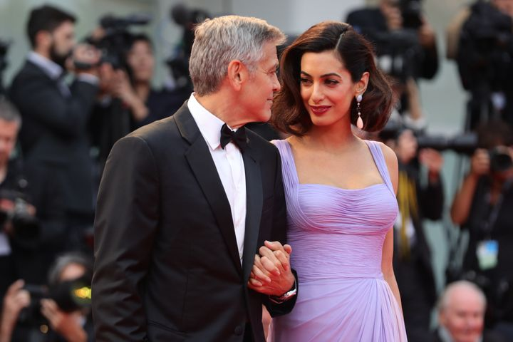"""George and Amal Clooney walk the red carpet ahead of the """"Suburbicon"""" screening during the 74th Venice Film Festival in 2017."""