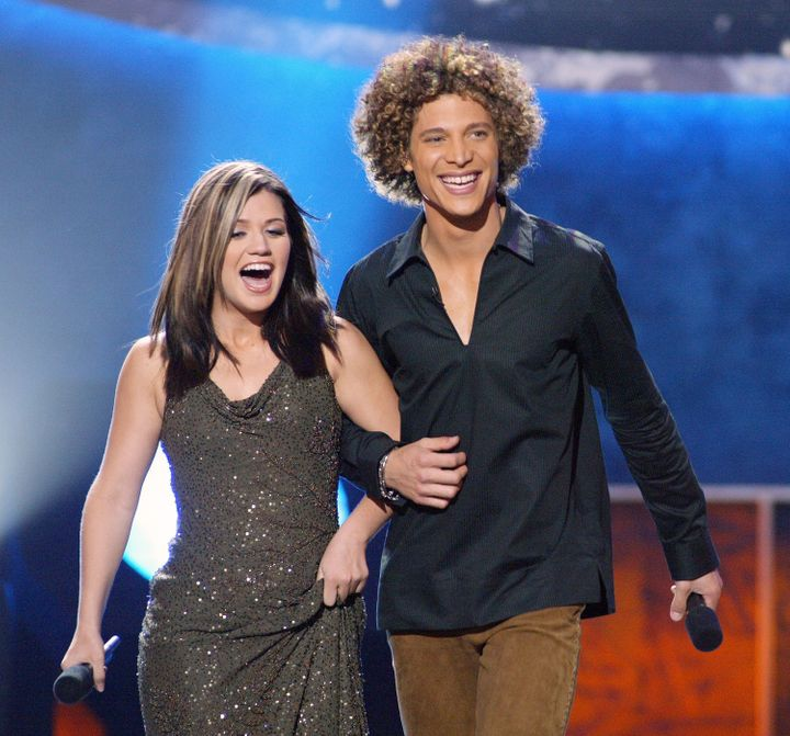 "Clarkson and Guarini during the 2002 finals of ""American Idol."""