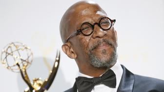 Reg E Cathey poses with his 2015 Emmy for House of Cards