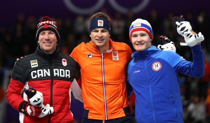 Silver medalist Ted-Jan Bloemen of Canada (left) gold medalist Sven Kramer of the Netherlands (center) and bronze medalist Sv