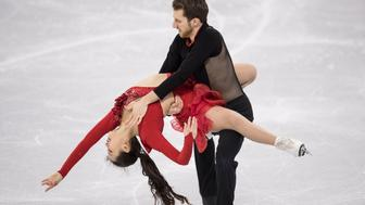 GANGNEUNG, SOUTH KOREA - FEBRUARY 11:  Yura Min and Alexander Gamelin of Korea compete in the Figure Skating Team Event - Ice Dance - Short Dance on day two of the PyeongChang 2018 Winter Olympic Games at Gangneung Ice Arena on February 11, 2018 in Gangneung, South Korea.  (Photo by XIN LI/Getty Images)