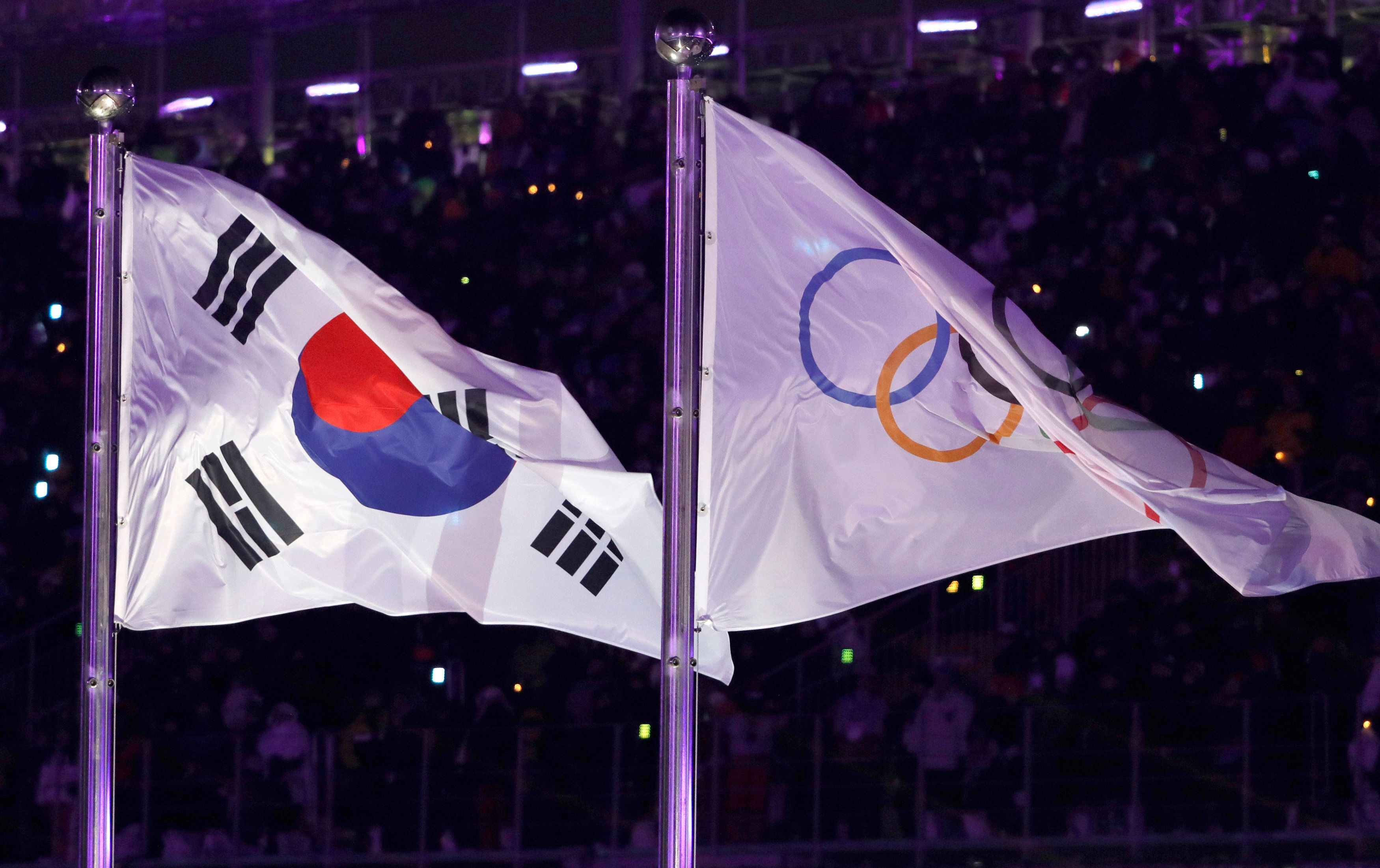 Pyeongchang 2018 Winter Olympics – Opening ceremony – Pyeongchang Olympic Stadium - Pyeongchang, South Korea – February 9, 2018 - South Korea's and Olympic flags flutter during the opening ceremony. REUTERS/Kim Kyung-Hoon