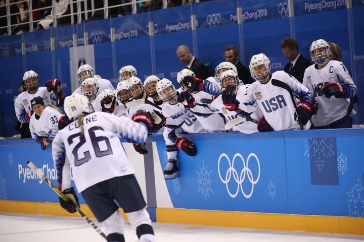 Kendall Coyne celebrates the go-ahead goal with teammates.
