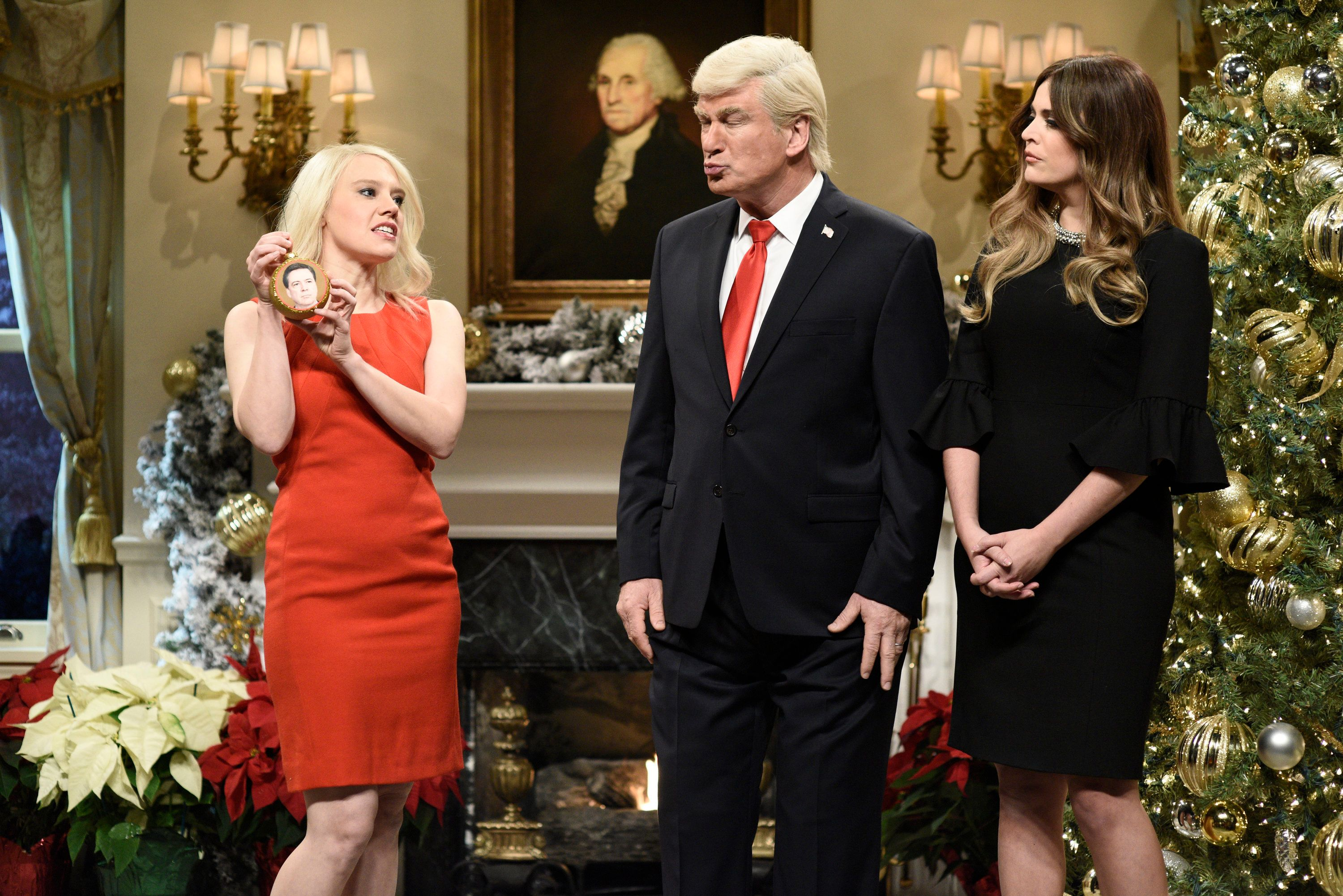 SATURDAY NIGHT LIVE -- Episode 1734 -- Pictured: (l-r) Kate McKinnon as Counselor to the President Kellyanne Conway, Alec Baldwin as President Donald J. Trump, Cecily Strong as First Lady Melania Trump during 'White House Tree Trimming Cold Open' in Studio 8H on Saturday, December 16, 2017 -- (Photo by: Will Heath/NBC/NBCU Photo Bank via Getty Images)