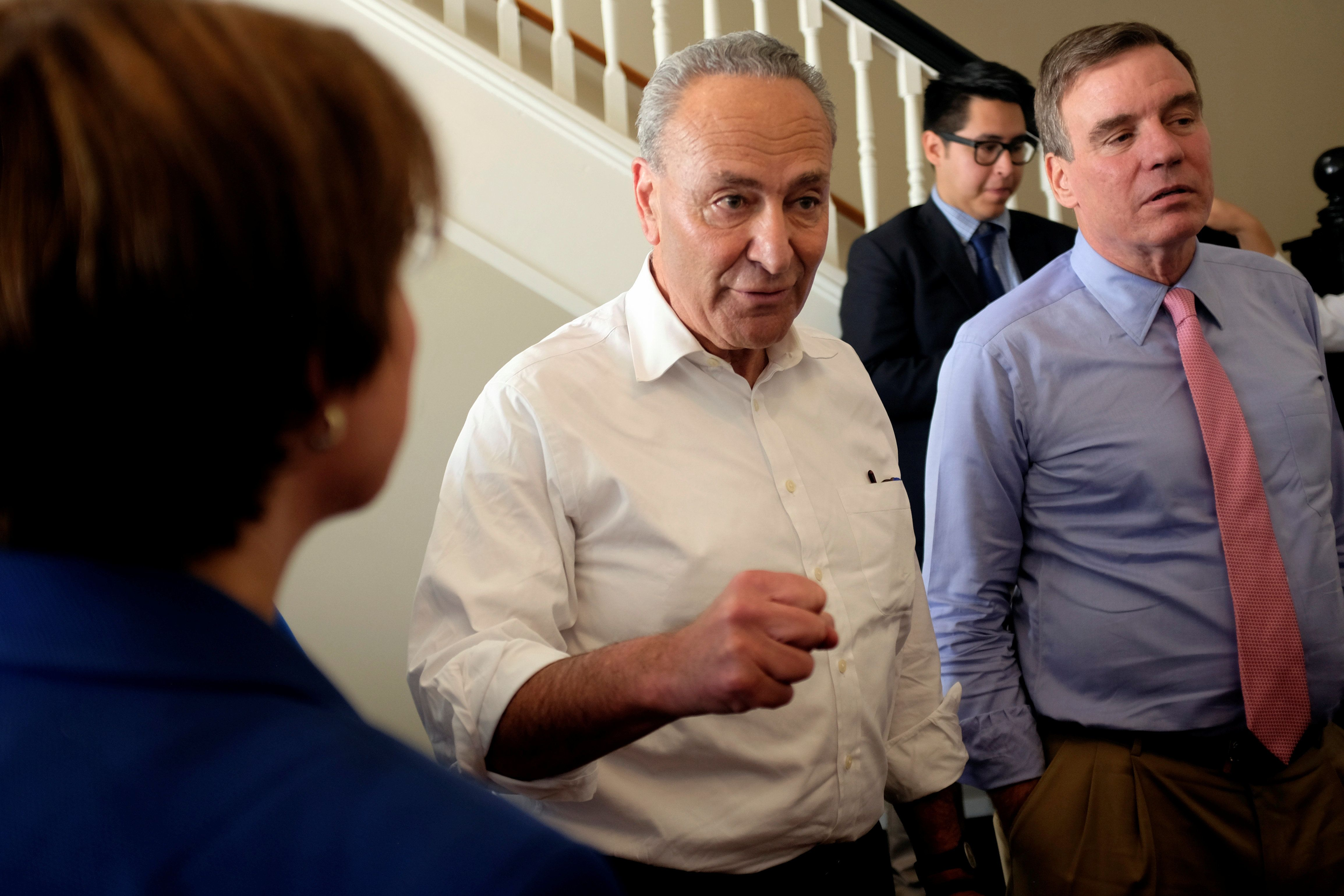 "Senate Minority Leader Chuck Schumer (D-NY) (C) huddles with Sen. Mark Warner (D-VA), and Sen. Amy Klobuchar (D-MN) (L) before unveiling the Democratic party's ""A Better Deal"" for working Americans in Berryville, Virginia, U.S., July 24, 2017. REUTERS/James Lawler Duggan"