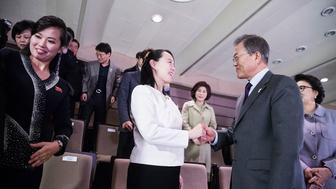 SEOUL, SOUTH KOREA - FEBRUARY 11:  In this handout image provided by the South Korean Presidential Blue House, South Korean President Moon Jae-in (R) shakes hands with Kim Yo-Jong (C), North Korean leader Kim Jong-Un's sister during a performance of North Korea's Samjiyon Orchestra at National Theater on February 11, 2018 in Seoul, South Korea.  (Photo by South Korean Presidential Blue House via Getty Images)