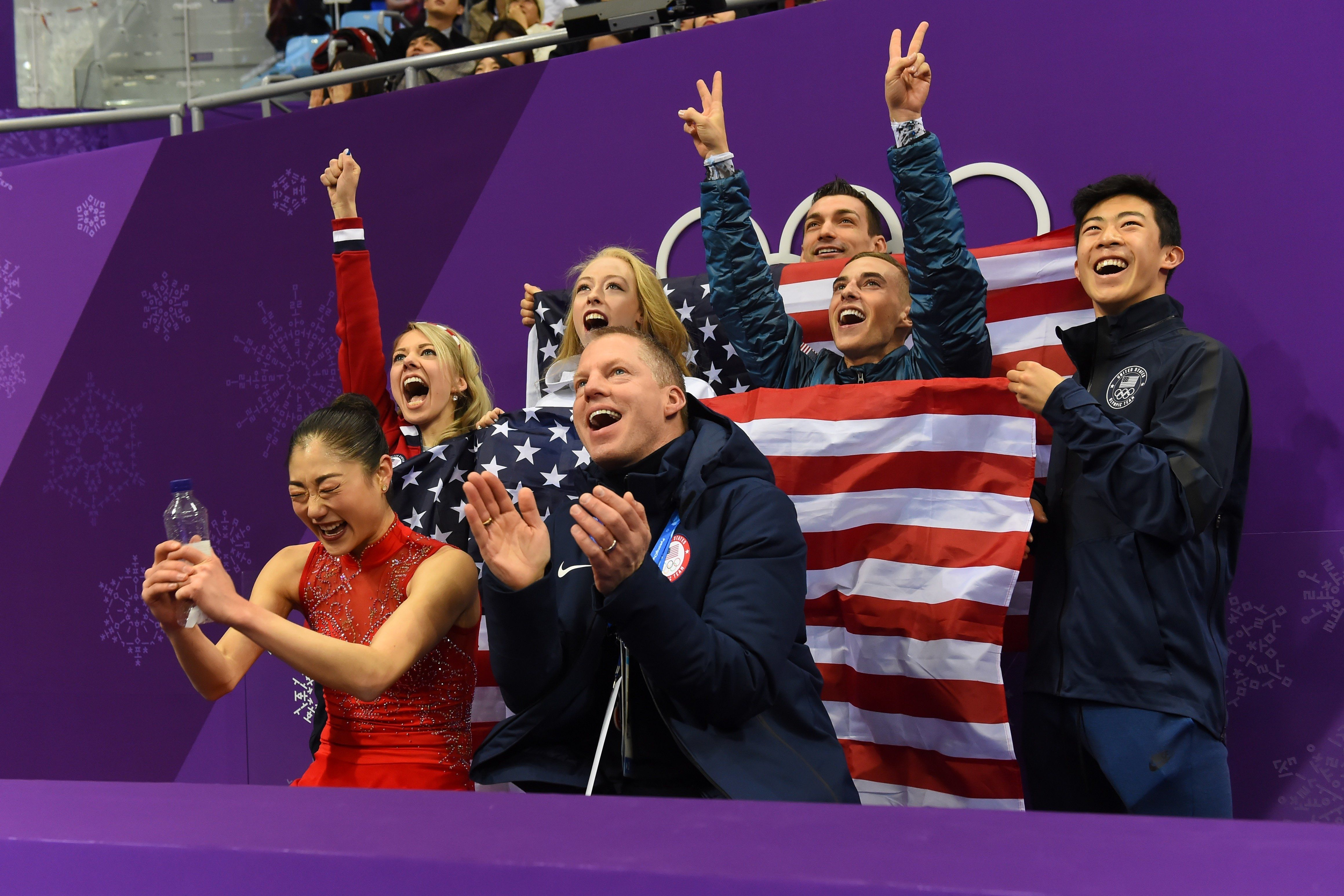USA's Mirai Nagasu (front L) reacts after competing in the figure skating team event women's single skating free skating during the Pyeongchang 2018 Winter Olympic Games at the Gangneung Ice Arena in Gangneung on February 12, 2018. / AFP PHOTO / Roberto SCHMIDT        (Photo credit should read ROBERTO SCHMIDT/AFP/Getty Images)