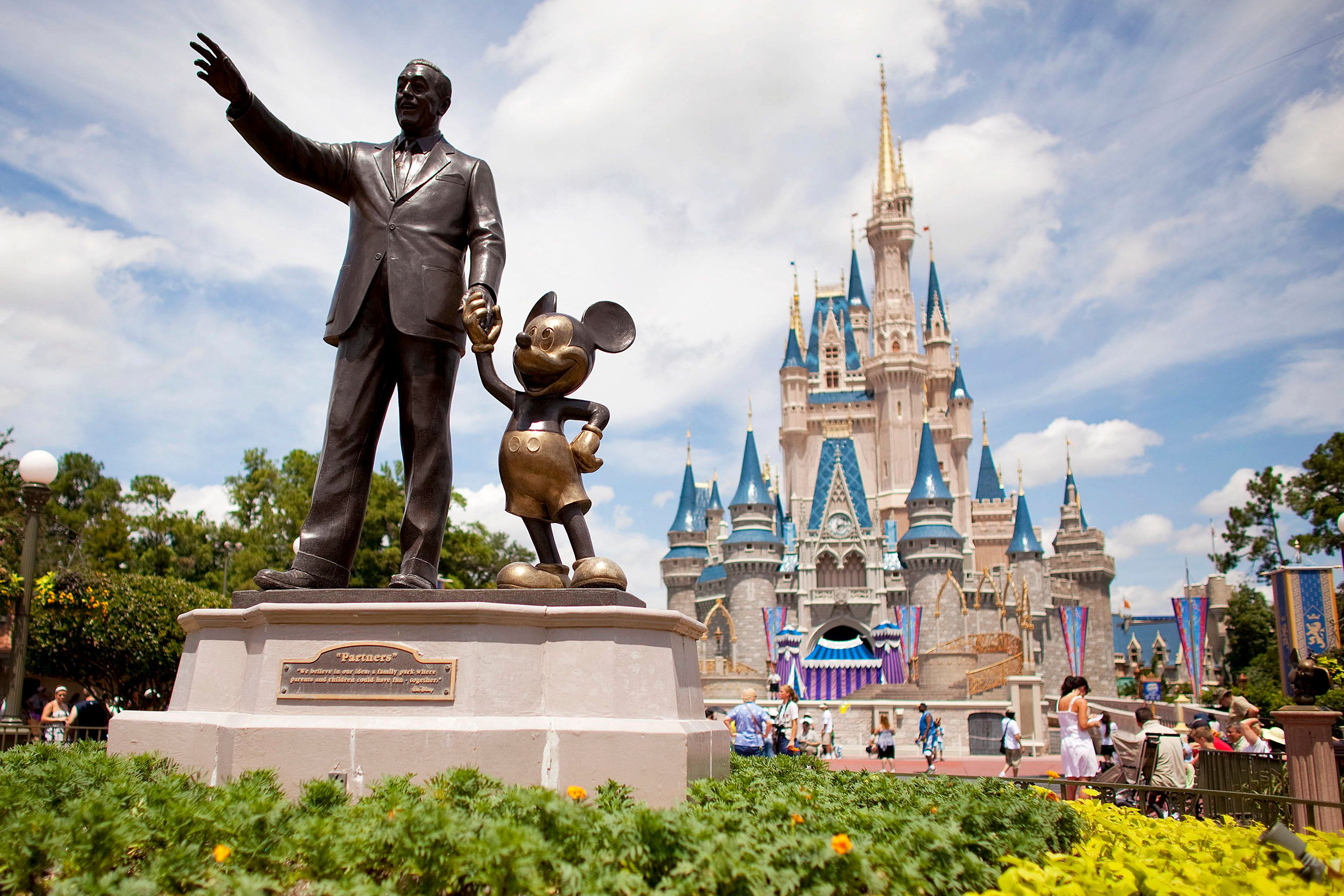 UNITED STATES - AUGUST 31:  'Partners,' a statue of Walt Disney and Mickey Mouse, sits in front of Cinderalla Castle at Magic Kingdom, part of the Walt Disney World theme park and resort in Lake Buena Vista, Florida, U.S., on Monday, Aug. 31, 2009. Walt Disney Co. said it agreed to buy Marvel Entertainment Inc. for about $4 billion in a stock and cash transaction, gaining comic book characters including Iron Man, Spider-Man and Captain America.  (Photo by Matt Stroshane/Bloomberg via Getty Images)