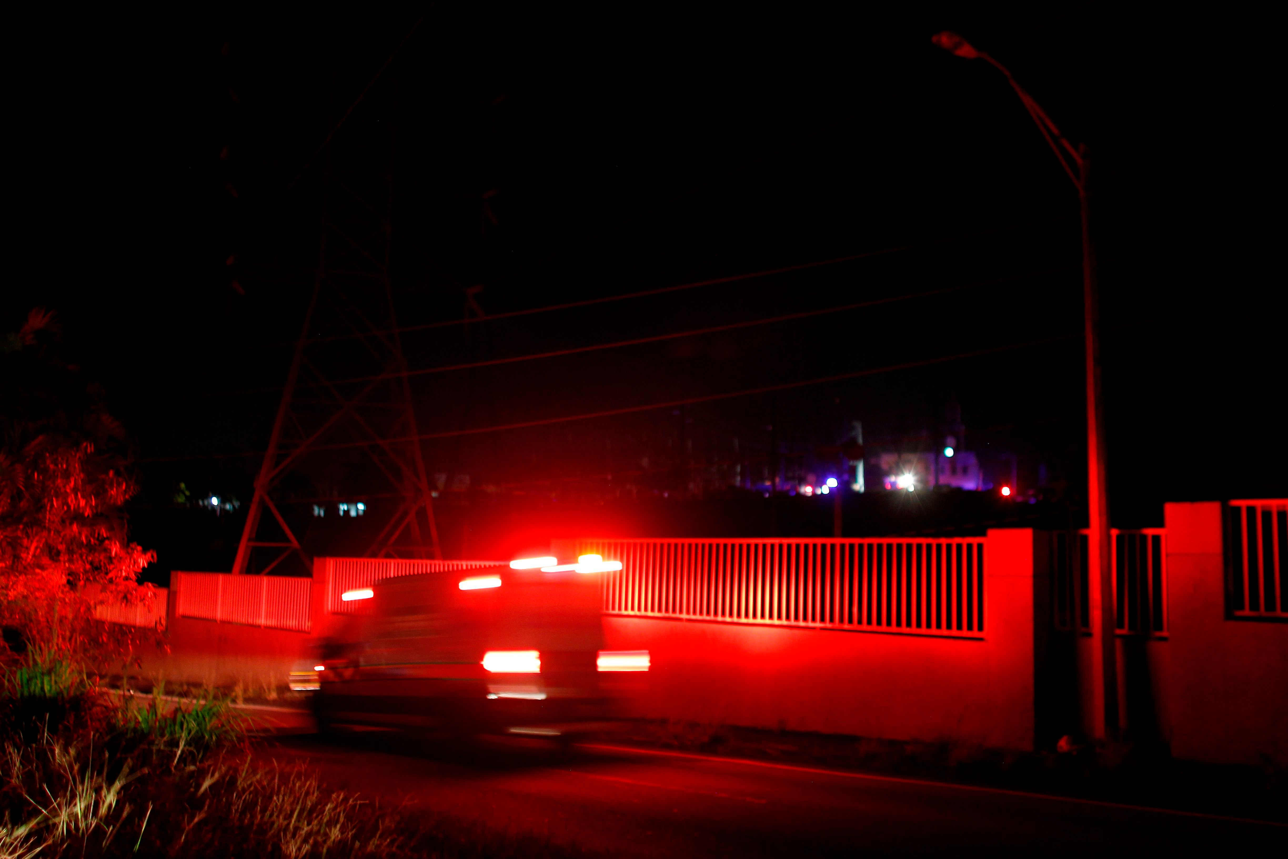 Ambulances are seen at the entrance of an electric substation after an explosion and fire was reported and caused a black out in parts of San Juan, on February 11, 2018. Most of San Juan and several other northern Puerto Rico municipalities were plunged into darkness Sunday night after the explosion, five months after two hurricanes destroyed the island's electricity network. The state electric power authority (AEE) said the blast was caused by a broken-down switch in Rio Piedras, San Juan, resulting in a blackout in central San Juan and Palo Seco in the north. 'We have personnel working to restore the system as soon as possible,' the AEE said.  / AFP PHOTO / Ricardo ARDUENGO        (Photo credit should read RICARDO ARDUENGO/AFP/Getty Images)