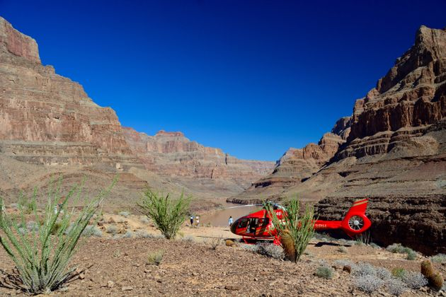 The distinctive red Papillon tour helicopters make dozens of trips to the Canyon each