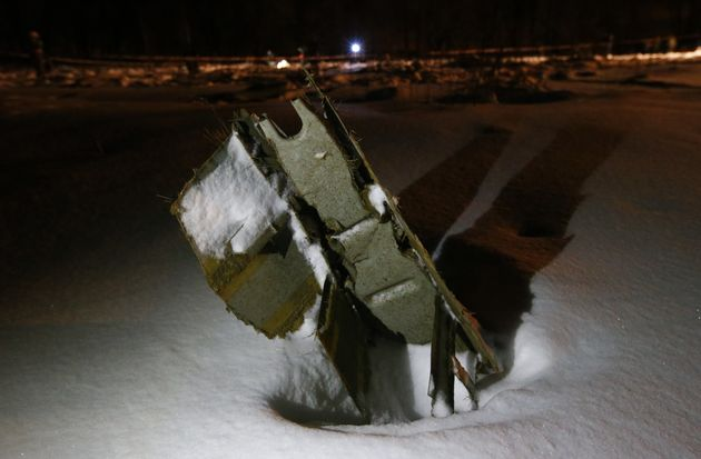 A part of the Saratov Airlines Antonov AN-148 plane embedded in the