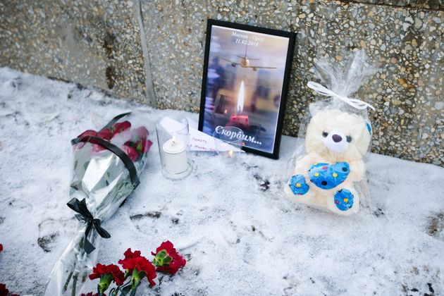 Flowers and tributes are left at a statue of Soviet pilot Valery Chkalov to pay tribute to the 71 people...