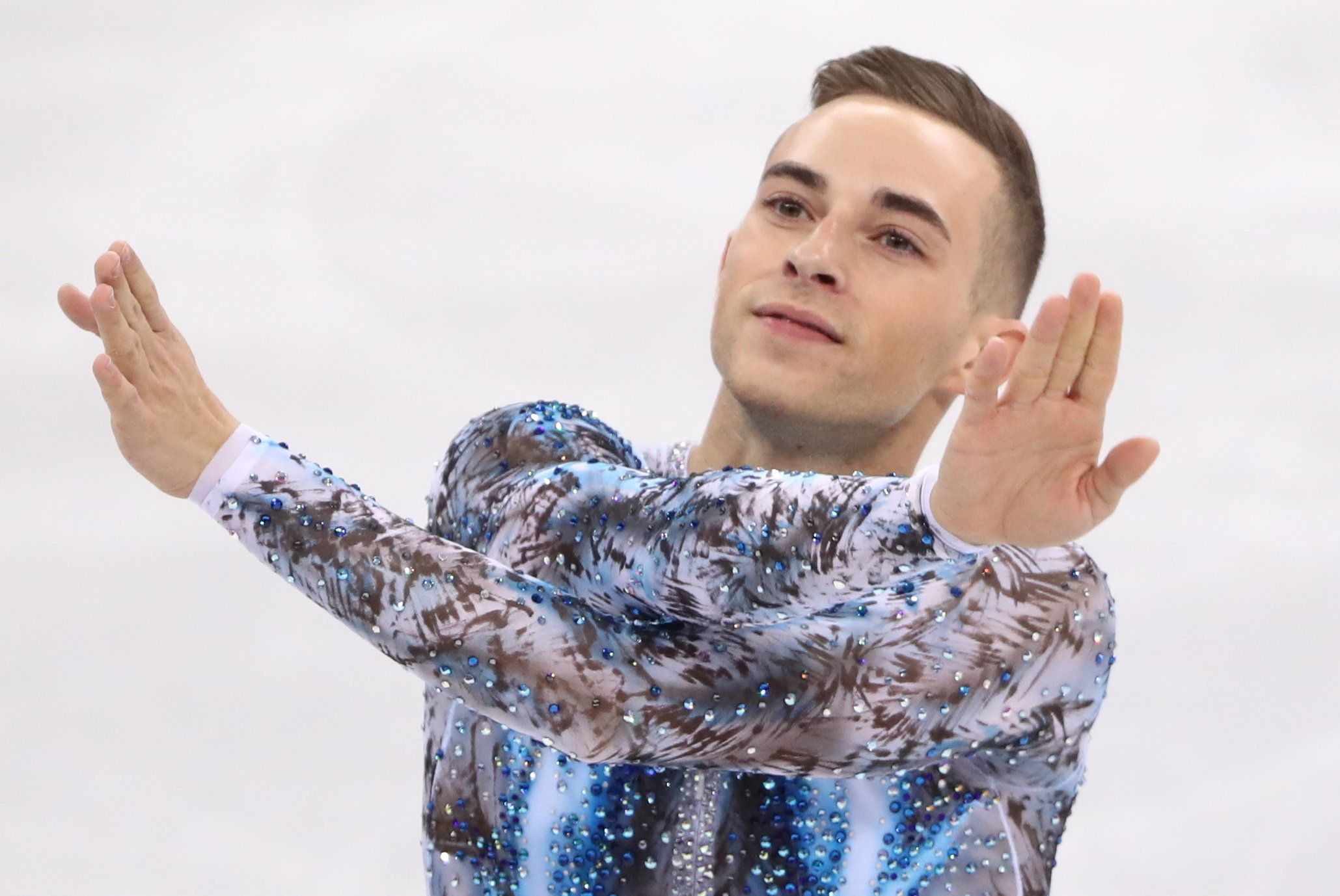 Adam Rippon finished third in the men's free skate of the team event to help Team USA to a bronze medal.