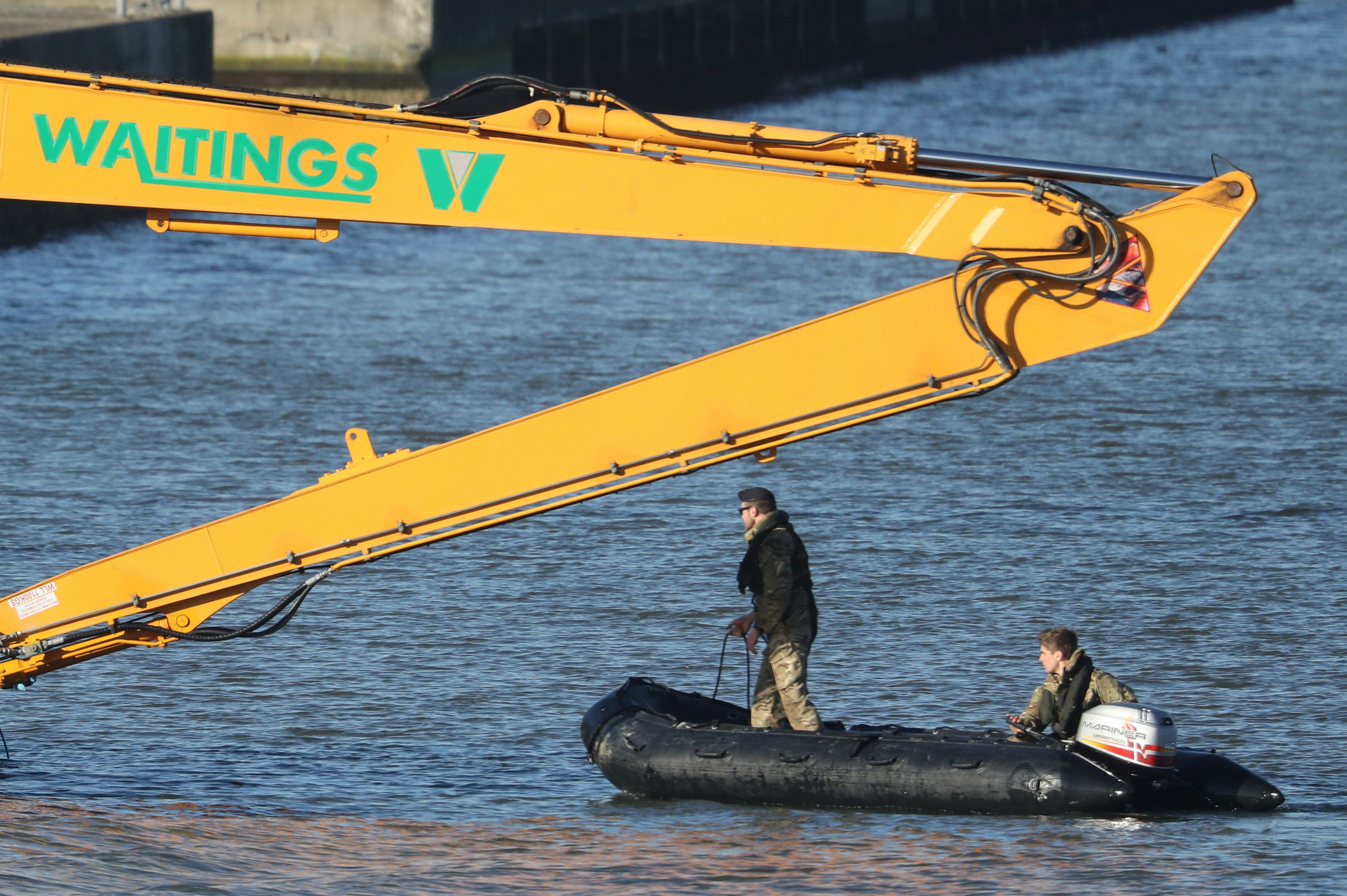 LONDON, UNITED KINGDOM - FEBRUARY 12:  A Royal Navy bomb disposal team investigate George V Dock after an unexploded 500kg World War Two bomb was found  in the River Thames on February 12, 2018 in London, England. The bomb was discovered on Sunday during scheduled work and a 214-metre exclusion zone was established whilst it was removed, forcing London City Airport to cancel all flights. (Photo by Dan Kitwood/Getty Images)