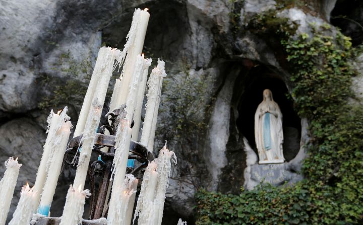 Lit candles are seen near the entrance to the Grotto of Massabielle in Lourdes, France, on Nov. 4, 2016.