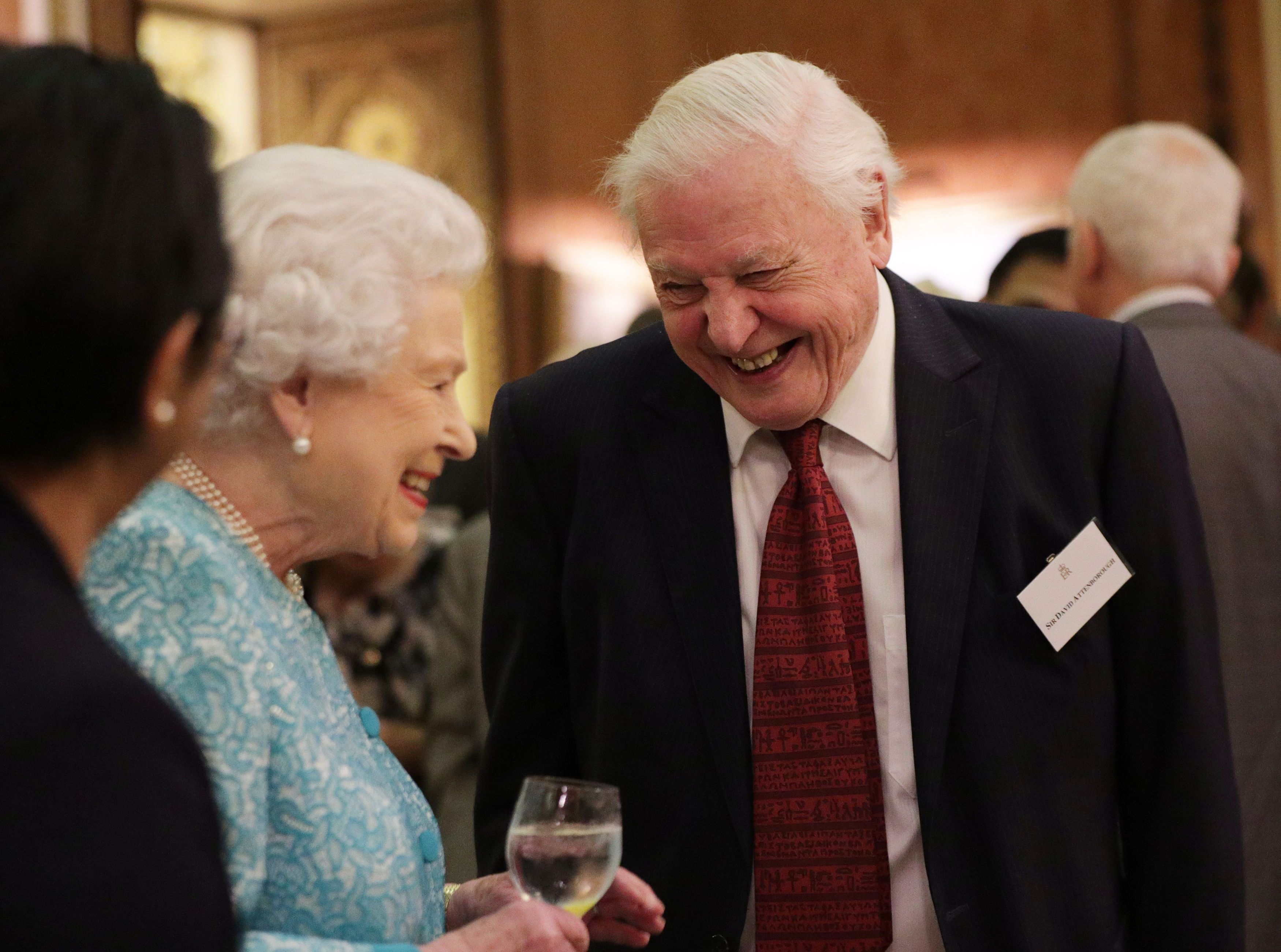 Queen Elizabeth II with Sir David Attenborough during an event at Buckingham Palace, London, to showcase forestry projects that have been dedicated to the new conservation initiative - The Queen's Commonwealth Canopy (QCC).