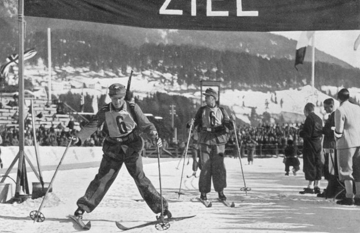 The German military ski patrol team crossing the finish line to take fifth place during the 1936 Winter Olympics in Garmisch-Partenkirchen, Germany.