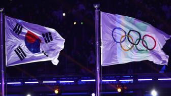 PYEONGCHANG-GUN, SOUTH KOREA - FEBRUARY 09:  The South Korean flag and the Olympic rings flag during the Opening Ceremony of the PyeongChang 2018 Winter Olympic Games at PyeongChang Olympic Stadium on February 9, 2018 in Pyeongchang-gun, South Korea.  (Photo by Ronald Martinez/Getty Images)