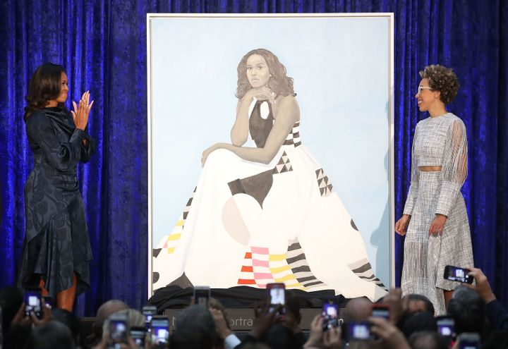 Former U.S. first lady Michelle Obama and artist Amy Sherald unveil Obama's portrait during a ceremony at the Smithsonian's N