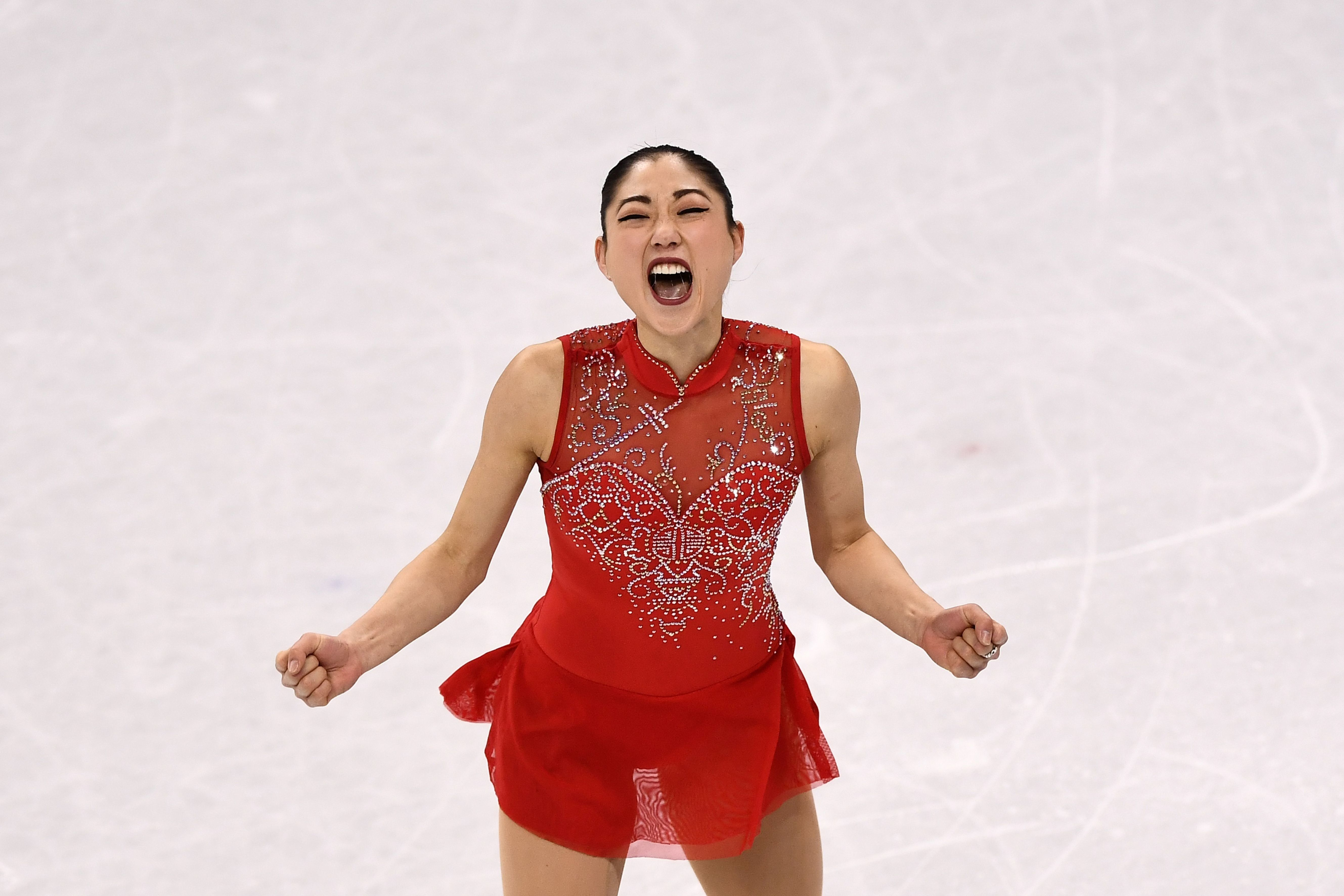 Mirai Nagasugives herself a well-deserved cheer afterher performance in the figure skating team event at the 2018