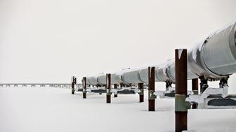 The first mile of the 800-mile Trans-Alaska Pipeline extends across the frozen tundra near the Alyeska Pipeline Services Co. pump station in Prudhoe Bay, Alaska, U.S., on Thursday, Feb. 16, 2017. Four decades after the Trans Alaska Pipeline System went live, transforming the North Slope into a modern-day Klondike, many Alaskans fear the best days have passed. Photographer: Daniel Acker/Bloomberg via Getty Images