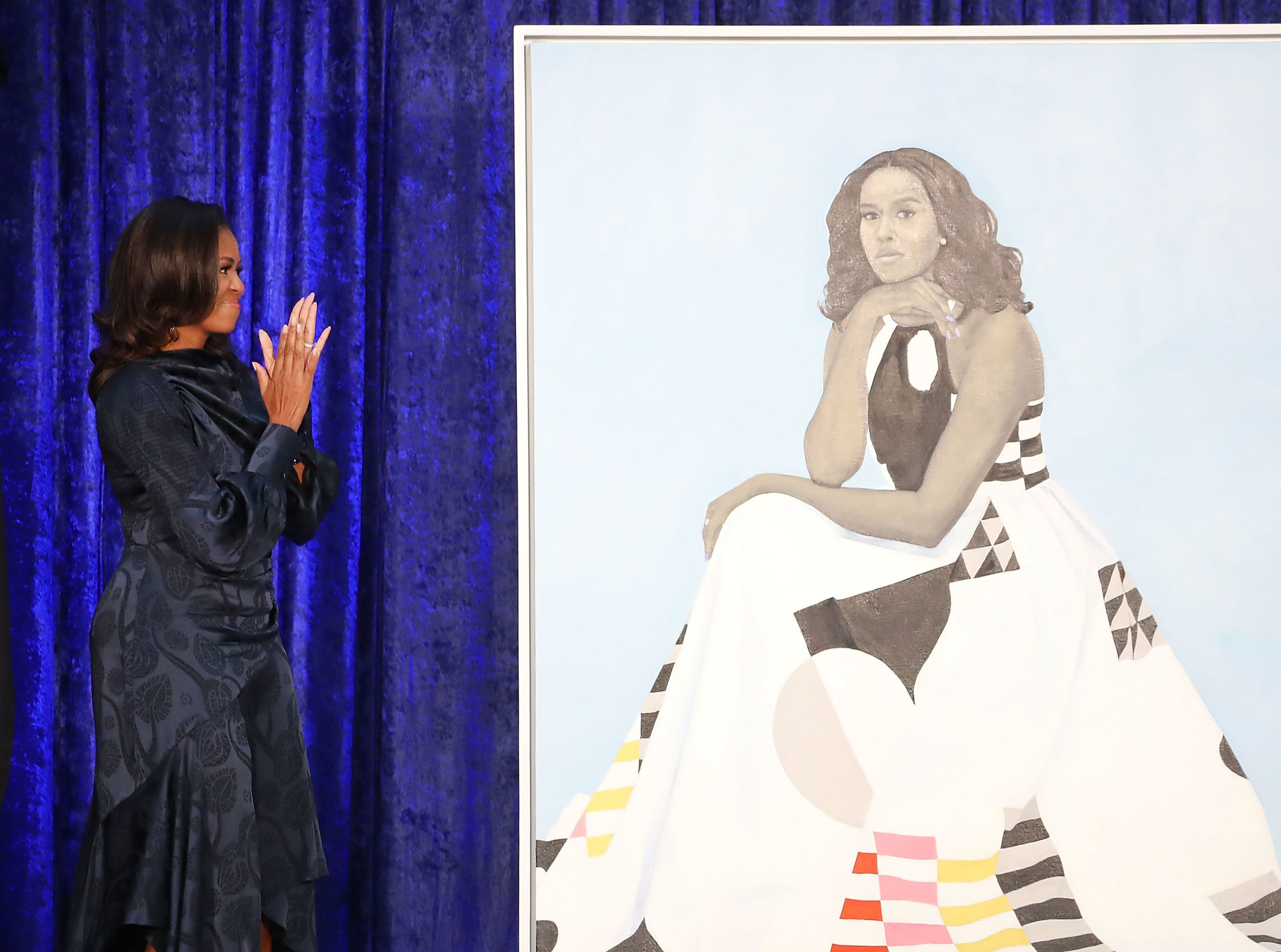 Mark Wilson via Getty Images                   A detail of artist Amy Sherald's portrait of Michelle Obama
