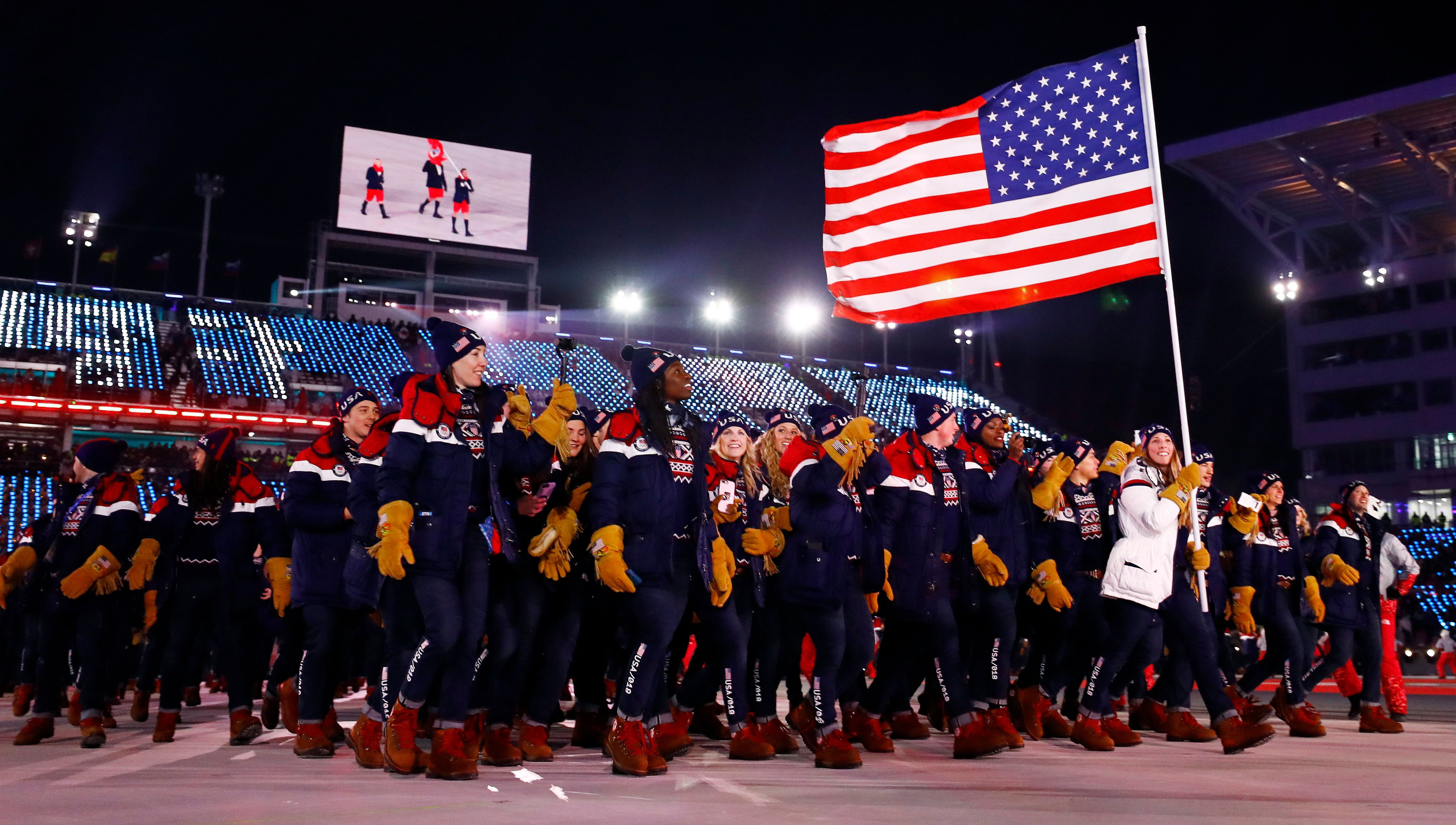 Pyeongchang 2018 Winter Olympics – Opening ceremony – Pyeongchang Olympic Stadium - Pyeongchang, South Korea – February 9, 2018 -  Erin Hamlin of the U.S. carries the national flag during the opening ceremony. REUTERS/Kai Pfaffenbach