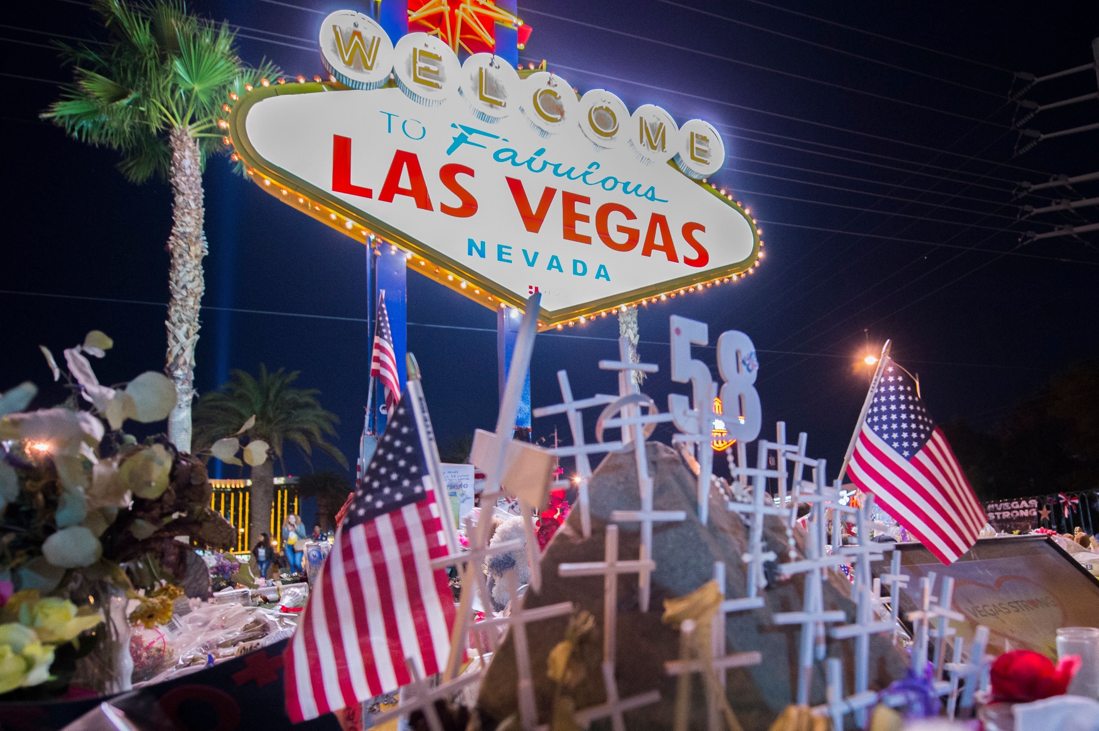 The area near The Fabulous Las Vegas Sign has become the memorial for the victims after the mass shooting in Las Vegas, Nevada, that took 58 lives, October 28, 2017. On the night of October 1, 2017, gunman Stephen Paddock opened fire from the 32nd floor of Mandalay Bay Resort and Casino on a crowd of concertgoers at the Route 91 Harvest music festival on the Las Vegas Strip in Nevada, leaving 58 people dead and 546 injured. (Photo by Yichuan Cao/NurPhoto via Getty Images)