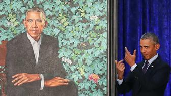 WASHINGTON, DC - FEBRUARY 12:  Former U.S. President Barack Obama stands next to his newly unveiled portrait during a ceremony at the Smithsonian's National Portrait Gallery, on February 12, 2018 in Washington, DC. The portraits were commissioned by the Gallery, for Kehinde Wiley to create President Obama's portrait, and Amy Sherald that of Michelle Obama.  (Photo by Mark Wilson/Getty Images)