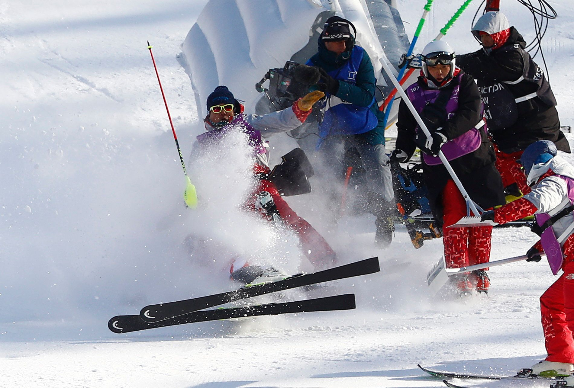 Alpine Skiing – Pyeongchang 2018 Winter Olympics – Men's Alpine Combined – Jeongseon Alpine Centre - Pyeongchang, South Korea – February 13, 2018 - Matthias Mayer of Austria crashes into media personnel during the Men's Slalom part of the Men's Alpine Combined. REUTERS/Dominic Ebenbichler