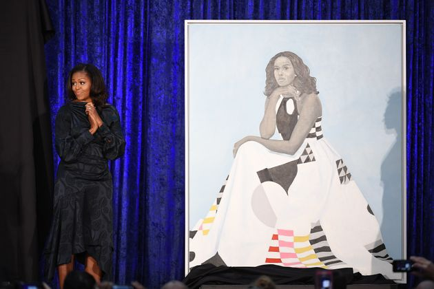 Former first lady Michelle Obama stands next to her