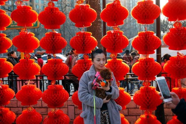 A woman being photographed at Beijing's Longtan Park at the start of Chinese New Year in