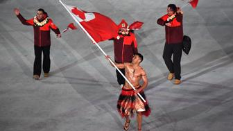 PYEONGCHANG-GUN, SOUTH KOREA - FEBRUARY 09:  Flag bearer Pita Taufatofua of Tonga and teammates enter the stadium during the Opening Ceremony of the PyeongChang 2018 Winter Olympic Games at PyeongChang Olympic Stadium on February 9, 2018 in Pyeongchang-gun, South Korea.  (Photo by Pool - Frank Fife/Getty Images)