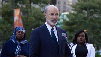 Pennsylvania Governor Tom Wolf, joined by Philadelphia Mayor Jim Kenney, and gun violence activist speak out against gun violence and call for gun law reform, at a October 3, 2017 vigil for the victims of the mass shooting in Las Vegas. The vigil is held outside City Hall, in Philadelphia, PA. (Photo by Bastiaan Slabbers/NurPhoto via Getty Images)