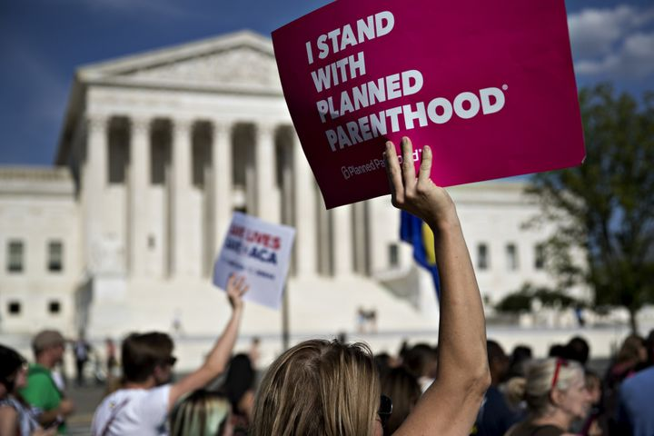 "A demonstrator holds a sign that reads ""I Stand With Planned Parenthood"" near the U.S. Supreme Court in Washington on June 28"
